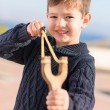Boy Aiming With A Slingshot - Stock Photo
