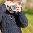 Little Boy Capturing Photo With Camera — Stock Photo #22626881
