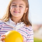 Happy Girl Holding Ball — Stock Photo #22627163