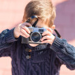 Little Boy Capturing Photo With Camera — Stock Photo #22627271