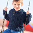 Royalty-Free Stock Photo: Little Boy Swinging In Playground