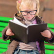 Cute Girl Reading Book - Stock Photo