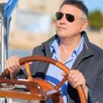 Mature Man Holding Steering Wheel Of Sailboat — Stock Photo