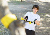 Young Man Exercising With Stretch Band — Stock Photo