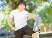 Portrait Of Young Man Stretching — Stock Photo