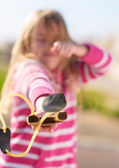 Girl Aiming With A Slingshot — Stock Photo