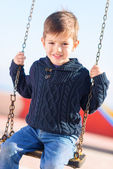 Little Boy Swinging In Playground — Stock Photo