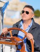 Mature Man Holding Steering Wheel Of Sailboat — Stock Photo