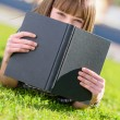 Woman Hiding Face With Book — Stock Photo