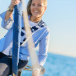 Mature Woman Sitting On Boat Railing — Stockfoto