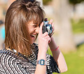 Woman Capturing Photo With Camera — Stock Photo