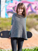 Happy Woman Holding Skateboard — Стоковое фото