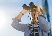 Mature Woman Looking Through Binocular — Stock Photo