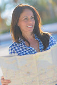 Happy Mature Woman Holding Map — Stock Photo