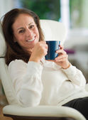Happy Mature Woman Drinking Coffee — Stock Photo
