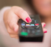 Hand Holding Remote — Stock Photo