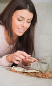 Happy Woman Counting Her Savings — Stock Photo