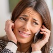 Stock Photo: Young WomCrying On Cell Phone