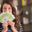 Happy Woman Holding Euro Currency — Stock Photo #22653857