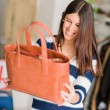 Royalty-Free Stock Photo: Happy Woman Looking At Hand Bag