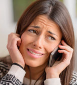 Young Woman Crying On Cell Phone — Stock Photo