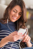 Woman Listening To Music On Headphones — Stock Photo