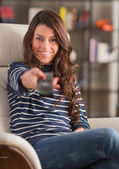 Happy Woman Holding Remote Control — Stock Photo