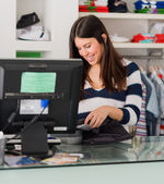 Happy Female Cashier At Cash Counter — Stock Photo