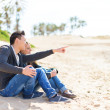 Stock Photo: Young Couple Sitting On Beach