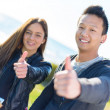 Young Couple Showing Thumb Up Sign — Stock Photo #23464192
