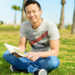 Man Holding Book In Park — Stock Photo