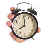 Human Hand Holding Alarm Clock — Stock Photo