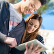 Young Couple Looking At Digital Tablet — Stock Photo