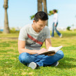 Man Reading Book In Park -  