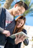 Young Couple Looking At Digital Tablet — Stockfoto