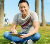 Young Man Holding Digital Tablet — 图库照片