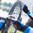 Close-up Of A Man's Hand Repairing Bicycle Wheel - Stockfoto