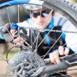 Young Man Repairing Bicycle Wheel — Stock Photo