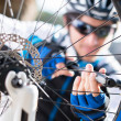 Male Cyclist Inflating Tire Of Bicycle - 图库照片