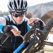 Young Man Repairing Bicycle - Stockfoto