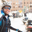 Young Male Cyclist Talking On Cell Phone — Stock Photo