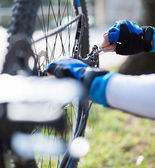 Close-up Of A Man's Hand Repairing Bicycle Wheel — Stock Photo