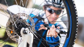 Male Cyclist Inflating Tire Of Bicycle — Stock Photo