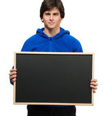 Young Man Holding Black Board — Stock Photo
