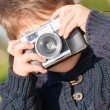Little Boy Capturing Photo With Camera - Zdjęcie stockowe
