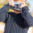 Little Boy Capturing Photo With Camera - Foto Stock