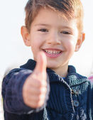 Small boy showing thumb up sign — Stock Photo