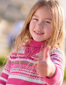 Little Girl Showing Thumb Up Sign — Stock Photo