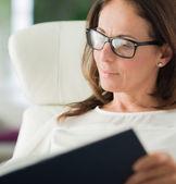 Mature Woman Reading Diary — Stock Photo