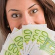 Happy Woman Holding Euro Currency — Stock Photo